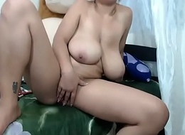 Huge tits milf shows hairy pussy